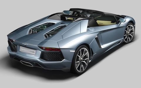 The rear cover of the Lamborghini Aventador roadster features hexagon-shaped windows that provide ventilation and a view of the V12 engine.