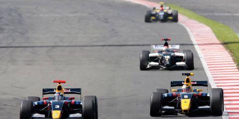 Newly-announced Toro Rosso teammates Daniel Ricciardo (left) fight Jean Eric Vergne (right) during the 2011British Formula Three race at Silverstone.