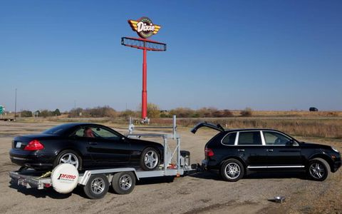 The trip west was made with a Porsche Cayenne towing a trailer loaded with a Mercedes-Benz SL. This is at the Dixie Truck Stop in Normal, Ill.