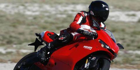 Motorcycle, Tire, Automotive design, Motorcycle helmet, Automotive tire, Automotive lighting, Sports gear, Helmet, Land vehicle, Motorcycling,
