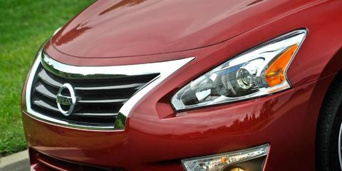 Front grille detail of the Nissan Altima shows Infiniti influence.