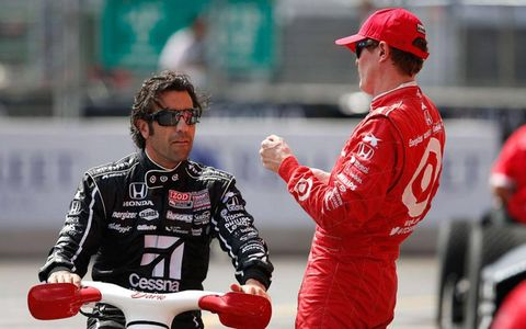 Dario Franchitti, left, chats with teammate and 2014 IndyCar champion Scott Dixon at Baltimore.