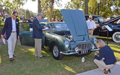 Judges pore over an Aston Martin DB6 in Winter Park Florida's Central Park during the 11th annual Winter Park Concours d'Elegance.