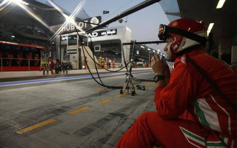 Yas Marina Circuit, Abu Dhabi: A Ferrari pit crew member waits for his call to action.