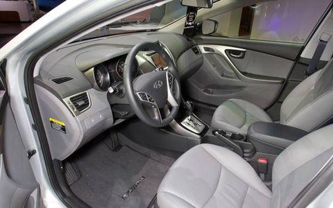 Motor vehicle, Mode of transport, Automotive design, Steering part, Steering wheel, Car seat, Car seat cover, Fixture, Vehicle door, Grey,