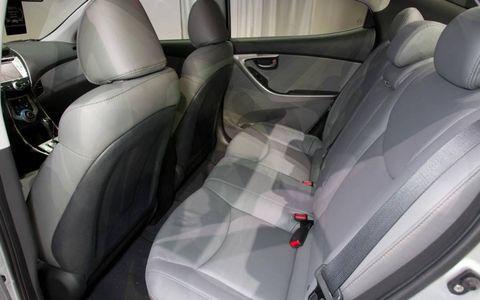 Motor vehicle, Mode of transport, Automotive design, Car seat, Vehicle door, Car, Head restraint, Car seat cover, Personal luxury car, Luxury vehicle,