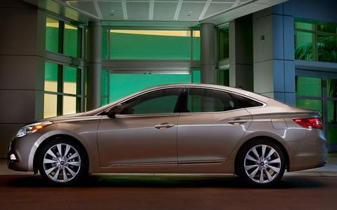 "The 2012 Hyundai Azera reflects their ""fluidic sculpture"" design theme."