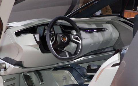 Motor vehicle, Mode of transport, Automotive design, Vehicle, Steering part, Steering wheel, Car, Vehicle door, Personal luxury car, Sports car,