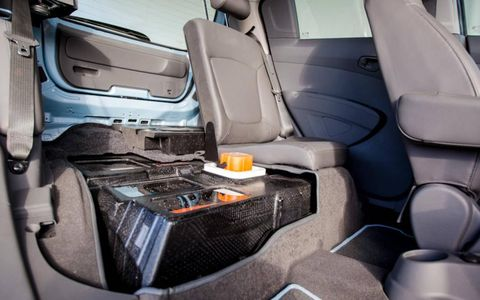 The 550-ish-pound battery pack takes up residence beneath the rear seats.
