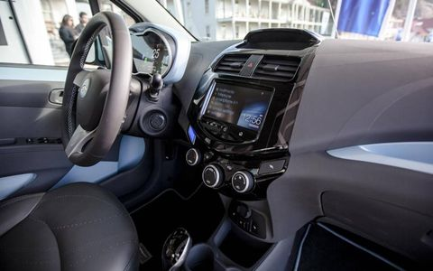 The Spark's cheap-and-cheerful interior gets a digital upgrade for EV duty.