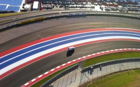 Sport venue, Race track, Automotive tire, Competition event, Racing, Auto racing, Carmine, Championship, Motorsport, Race car,