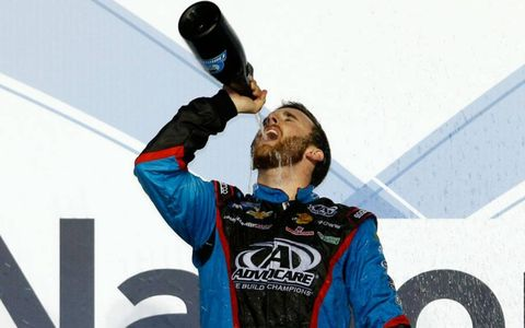 Austin Dillon tastes the champagne after clinching the NASCAR Nationwide Series title.