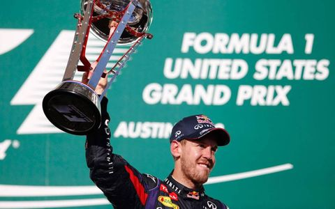 Sebastian Vettel raises the trophy after winning at Circuit of the Americas on Sunday.