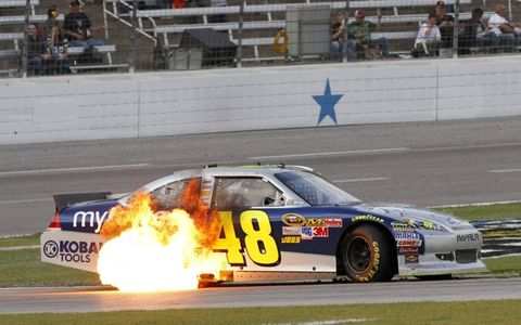 Flame Throwing // Jimmie Johnson's car shoots fire as he restarts the engine at Texas Motor Speedway on Nov. 6. Photo by: Lesley Ann Miller/LAT Photographic