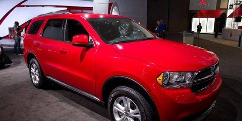 Tire, Wheel, Motor vehicle, Automotive design, Vehicle, Automotive tire, Land vehicle, Automotive exterior, Car, Red,