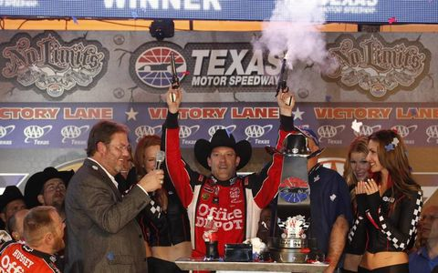 Gunslinger // Tony Stewart celebrates his Sprint Cup victory at Texas Motor Speedway on Nov. 6. Photo by: Michael L. Levitt/LAT Photographic