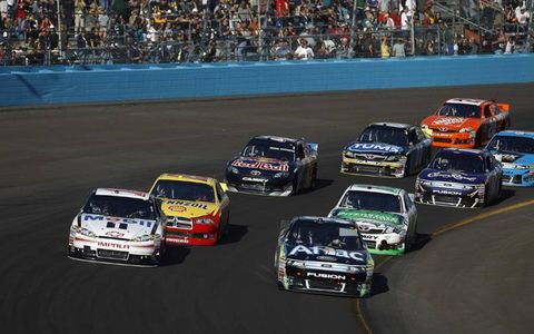 Title contenders Carl Edwards (right) and Tony Stewart (left) lead the field during a restart. Photo by: Michael L. Levitt/LAT Photographic