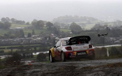 Sébastien Ogier crests the hill in his Citroën WRC during a muddy stage of Rally Great Britian. Photo by: McKlein/LAT Photographic