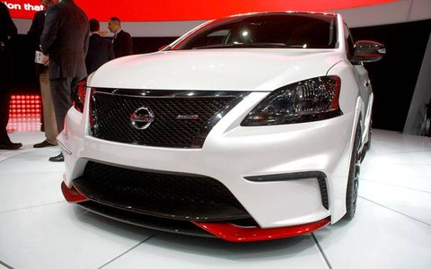 The Black Chrome grille looks trick, sufficiently shiny. Subtle red touches are a Nismo trademark.