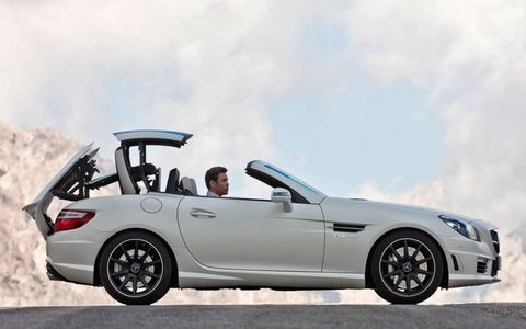 The power-folding hardtop convertible roof on the 2012 Mercedes-Benz SLK55 AMG contributed to an overall curb weight almost 600 pounds heavier than the Boxster S, making it an odd addition to a performance-oriented machine.