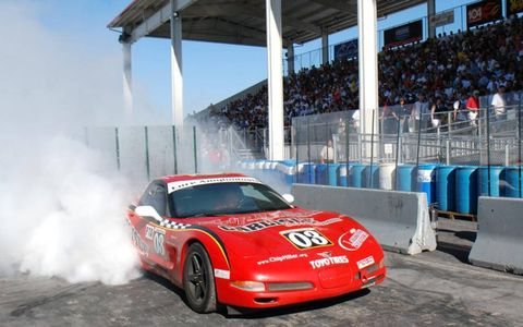 Tire, Wheel, Automotive design, Vehicle, Sport venue, Land vehicle, Sports car racing, Motorsport, Car, Performance car,