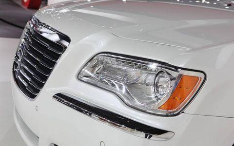 Automotive design, Automotive lighting, Vehicle, Headlamp, Automotive parking light, Grille, Automotive exterior, White, Hood, Light,
