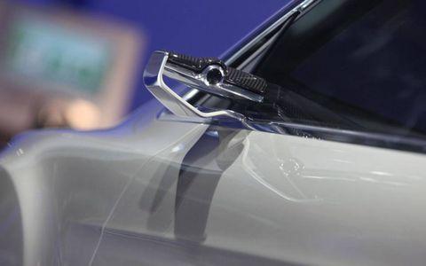 Automotive exterior, Automotive design, Glass, Logo, Electric blue, Material property, Hood, Luxury vehicle, Gloss, Transparent material,