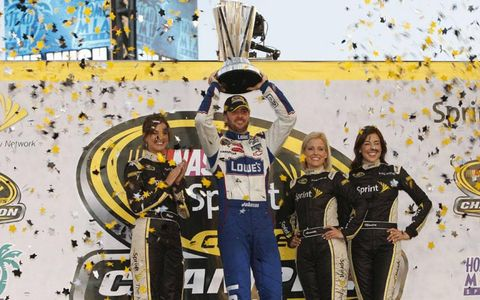 Jimmie Johnson holds the championship trophy.