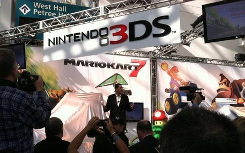 Reggie Fils-Aime gets ready to pull back the covers on the new Mario Karts