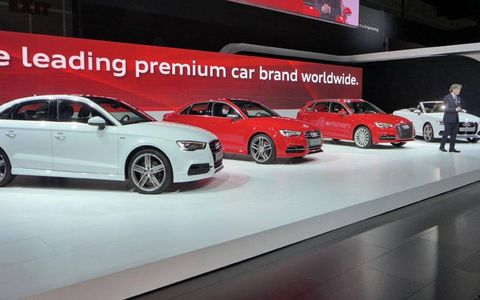 Audi sales boss Luca de Meo in front of the happy A3 family.