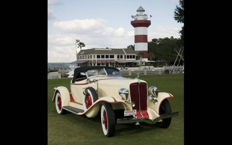 Motor vehicle, Tire, Automotive design, Automotive lighting, Tower, Classic car, Fender, Classic, Antique car, Vehicle door,