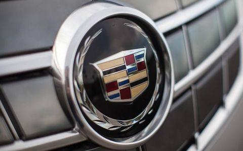 Motor vehicle, Automotive design, Grille, Logo, Emblem, Symbol, Parallel, Brand, Trademark, Steel,