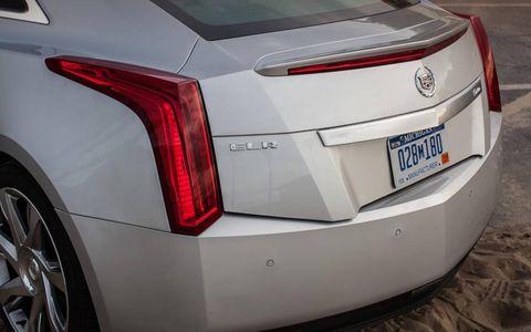 Automotive tail & brake light, Automotive design, Vehicle, Automotive exterior, Car, Automotive lighting, White, Rim, Automotive tire, Fender,