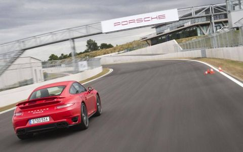 The 2014 Porsche 911 Turbo S races down the track. The Turbo S can accelerate from 0-60 in just 2.7 seconds.