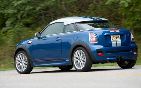 The fixed roof of the 2012 Mini John Cooper Works Coupe, combined with its curb weight of 2,701 and a stiff suspension, make it the most performance-oriented Mini yet.