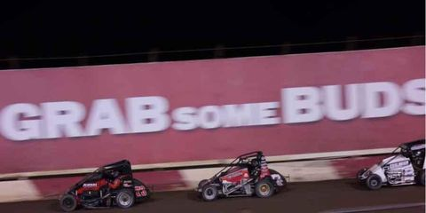 Dave Darland took the lead with four to go to win the 73rd Turkey Night Grand Prix.