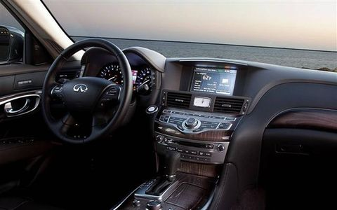 Motor vehicle, Steering part, Brown, Product, Steering wheel, Automotive design, Transport, Automotive mirror, Vehicle audio, Electronic device,