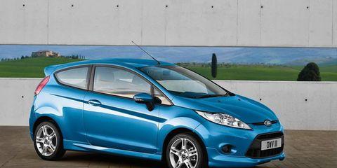 Tire, Wheel, Motor vehicle, Mode of transport, Automotive design, Blue, Vehicle, Transport, Automotive mirror, Automotive wheel system,