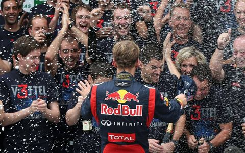 SNOWING IN BRAZIL? // Scuderia Toro Rosso driver Sebastian Vettel faces a blizzard of champagne spray following his sixth-place finish in the Brazilian Formula One Grand Prix. Jenson Button may have won the race, but Vettel took enough points to become the 2012 Formula One series champion. Photo by Steve Etherington/LAT Photographic