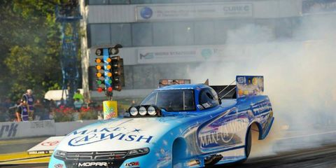 Tommy Johnson Jr. took the top qualifying spot for NHRA Funny Cars on Saturday in New England.