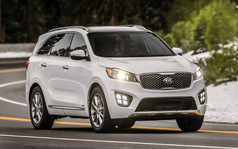 The 2017 Kia Sorento SXL is shown, which adds chrome 19-inch wheels and LED front fog lights.