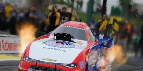 Robert Hight turned in a 3.826-second pass at a national-record 337.66 mph on Friday night in Kansas.
