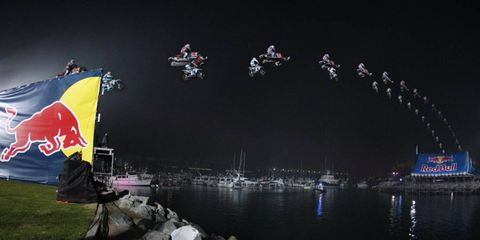 HAAPPYY NEEWWW YEEAARRRRR!!!! // Robbie Maddison and Levi LaVallee ring in 2012 with their combination snowmobile-ATV leap in this time-lapse shot taken during the Red Bull New Year No Limits party in San Diego.