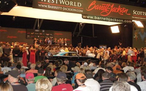 A Superbird on the block at Barrett-Jackson with Richard Petty, Goldberg and drag racer Darrell Gwynn, among many others, on stage