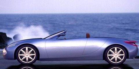 """>> NO. 1 - BUICK BENGAL: Our 2001 Best Concept winner (we called it """"an elegant car in a year of lumpish vehicles""""), Bengal was a convertible with a Saturn-like third door and rear seating for either two golf bags or two humans. Its name reflected Buick's tie-up with golf's Tiger Woods. Visually and dimensionally, Bengal wasn't far from a Porsche Boxster, four inches longer and 3.4 inches wider. The front-drive car had a supercharged 3.4-liter, 250-hp V6 mated to a six-speed automatic. """"Let's just hope we see this car again somewhere besides as a prop for Buick promotions on the PGA tour,"""" we said. We're still waiting."""