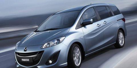 Motor vehicle, Tire, Wheel, Mode of transport, Automotive design, Daytime, Automotive mirror, Transport, Glass, Vehicle,