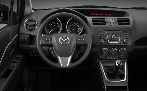 Motor vehicle, Steering part, Mode of transport, Steering wheel, Automotive design, Transport, Automotive mirror, Speedometer, Center console, White,