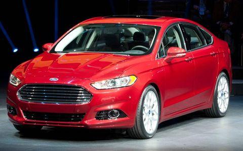 Tire, Wheel, Automotive design, Vehicle, Car, Red, Automotive lighting, Automotive tire, Headlamp, Full-size car,