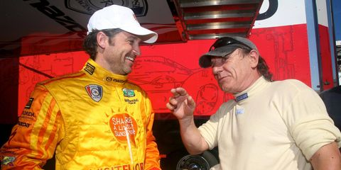 Patrick Dempsey, a star on ABC-TV's Grey's Anatomy, and Brian Johnson, lead singer for rock band AC/DC, compare notes at Daytona International Speedway.