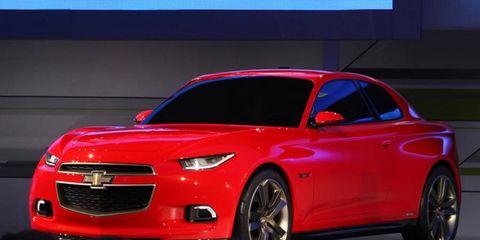 Tire, Wheel, Automotive design, Vehicle, Automotive lighting, Performance car, Automotive tire, Red, Car, Hood,